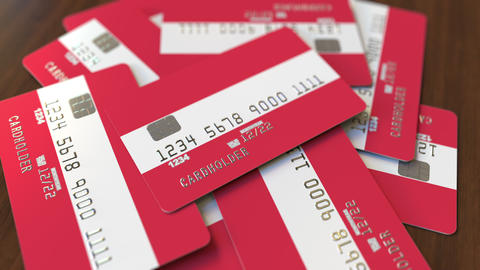Pile of credit cards with flag of Austria. Austrian banking system conceptual 3D Footage