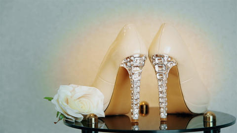 Wedding high-heeled shoes decorated with precious transparent stones HD Live Action