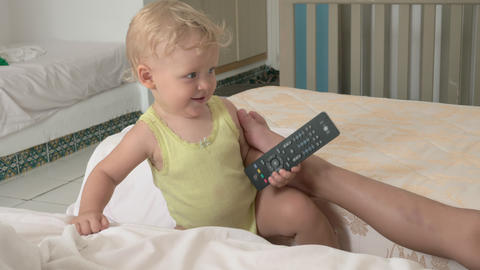 A baby girl and her elder brother playing on mattresses Footage