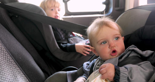Cute girl and boy sitting in car back seat Footage