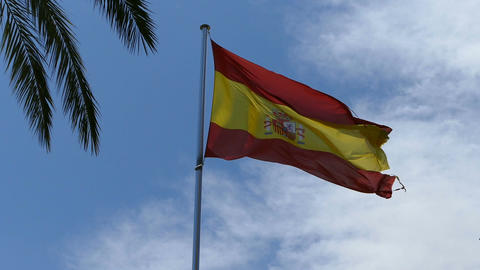 Spanish flag at cloudy sky Footage