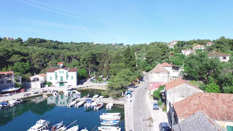 Aerial drone scene of harbor in Solta, Croatia. Detail of dock where the sailboa Footage