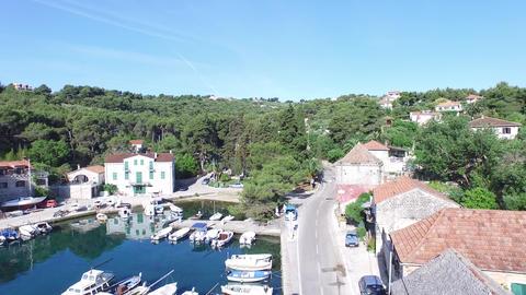 Aerial drone scene of harbor in Solta, Croatia. Detail of dock where the sailboa Footage