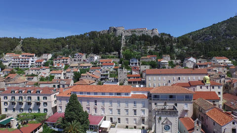 Aerial drone scene of little European town with a castle, fort at the top of a m Footage