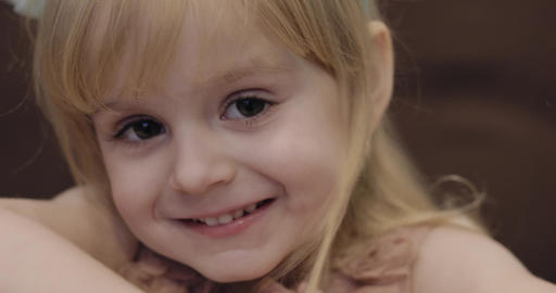 Happy three years old girl. Cute blonde child. Brown eyes. Cute girl make faces Footage