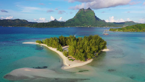 Bora Bora in French Polynesia aerial view of Motu coral lagoon and Mount Otemanu Footage