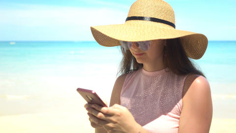 traveler woman using phone app on beach at summer vacation Footage