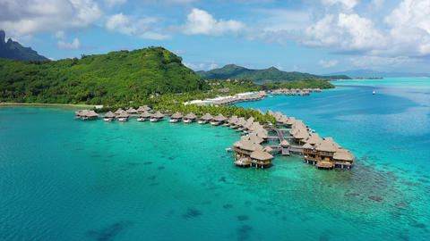 Travel vacation paradise aerial video with overwater bungalows in coral reef sea Footage