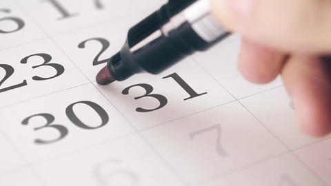 Marked date in the calendar transforms into NEW YEAR words Footage