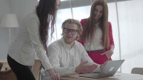 Portrait successful blond man in glasses sitting in a light comfortable office Live Action