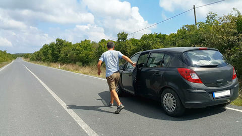 Car malfunction on countryside. Car waiting for help on the road. Car breakdown. Man with car Live Action