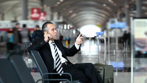 Passenger business man passenger at the airport talking with phone Footage