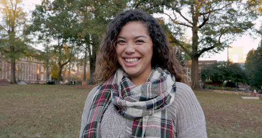 Portrait of a beautiful multi ethnic mixed race woman college student smiling and laughing while Footage