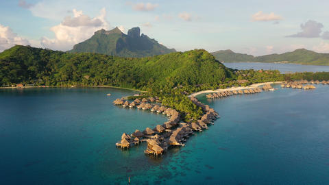 Aerial video of Tropical vacation paradise island overwater bungalows Bora Bora Footage