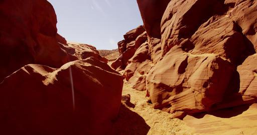 Traveling shot inside a natural geological formation showing orange walls and Live Action