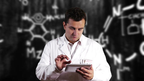 Scientist using Tablet PC with Scientific Chemistry Background 8 Footage