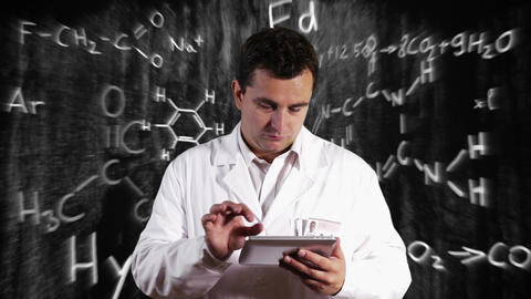 Scientist using Tablet PC with Scientific Chemistry Background 12 Footage