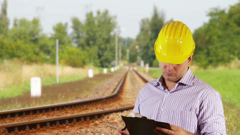 Young Engineer Checking Contract Railway 1 Stock Video Footage
