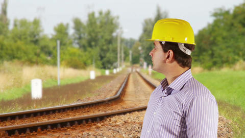 Young Engineer Looking Around Railway 2 Stock Video Footage