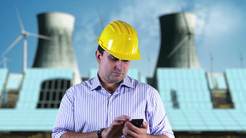 Young Engineer Smart Phone Energy Concept 1 Stock Video Footage