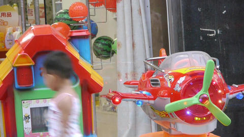 Toy plane & house and young children Footage