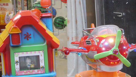 Toy plane & house and young children Stock Video Footage