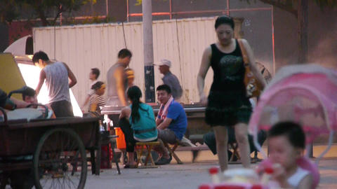 Street barbecue,busy vendors pedestrian on night market Stock Video Footage