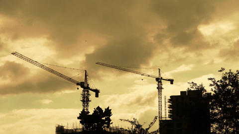 Construction-cranes,clouds cover sky,building high-rise,House silhouette Footage