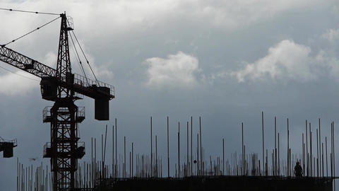 Construction-cranes,clouds cover sky,building high-rise,House silhouette.Constru Footage