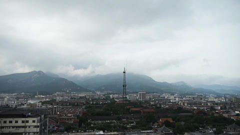 Clouds on top of hill,City buildings relying on mountain.Panoramic of Taishan,Ta Footage