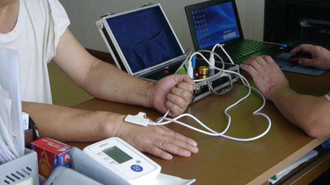 Doctor Check Blood Pressure For Patient Use Electronic Equipment stock footage
