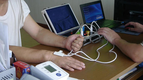 Doctor check blood pressure for patient use electronic... Stock Video Footage