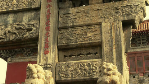 China stone arch & stone lions in front of ancient city gate Footage