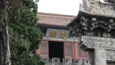 China tower & stone lions in front of ancient city gate Footage