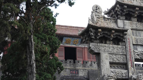 China tower & stone lions in front of ancient city gate Stock Video Footage