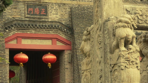 China lantern & stone lions in front of ancient city... Stock Video Footage