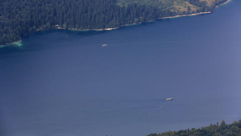 Timelapse - Two boats crossing a huge blue lake Footage
