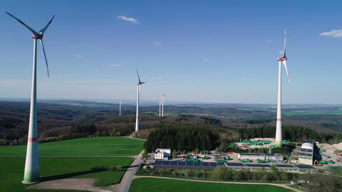 Wind turbine park and solar collectors - aerial view Footage
