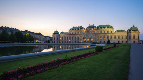 Belvedere Garden Palace in Vienna, Austria at night with city skyline time lapse Footage