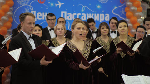 Performance of Russian choir with director at Moscow airport Archivo