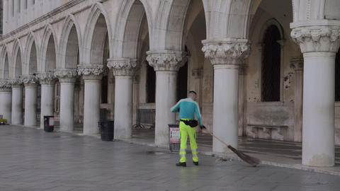 Street cleaner sweeping St Marks Square in the morning Footage