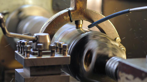 Facing operation of a metal blank on turning machine with cutting tool Footage