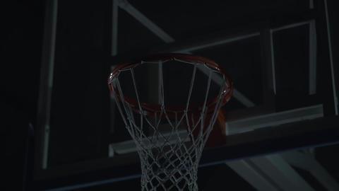Basketball net close up. A man, player put a ball inside basketball hoop Acción en vivo