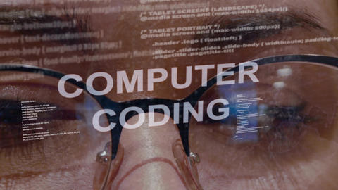 Computer coding text on background of female developer Footage