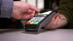 Close-up shot of person applies credit card to terminal performing contactless Footage
