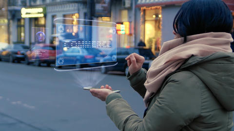 Woman interacts HUD hologram with text Commerce Footage
