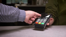 Close-up shot of person using terminal and credit card performing contactless Footage