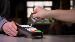 Close-up shot of female hand enters the pin code on terminal performing payment Footage