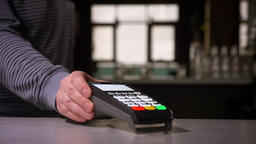 Close-up shot of person puts the terminal machine on the table and takes it away Footage
