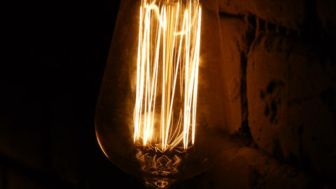 Bulb close-up. The light flashes. Vintage lighting... Stock Video Footage